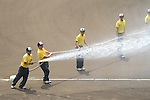 General view,<br /> AUGUST 25, 2014 - Baseball :<br /> Members of the grounds crew water the field before the 96th National High School Baseball Championship Tournament final game between Mie 3-4 Osaka Toin at Koshien Stadium in Hyogo, Japan. (Photo by Katsuro Okazawa/AFLO)