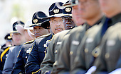 Police Officers attend the National Peace Officers Memorial Service, an annual ceremony honoring law enforcement who were killed in the line of duty in the previous year, at the US Capitol in Washington, DC, May 15, 2015.<br /> Credit: Olivier Douliery / Pool via CNP