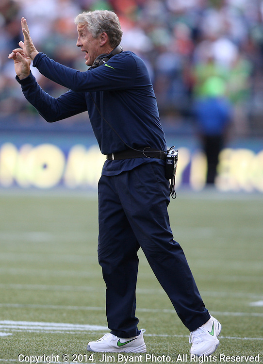 Seattle Seahawks head coach Pete Carroll send  in a  signal during the game against the  Denver Broncos at CenturyLink Field in Seattle, Washington on September 21, 2014. The Seahawks won 26-20 in overtime.    ©2014. Jim Bryant Photo. All rights Reserved.