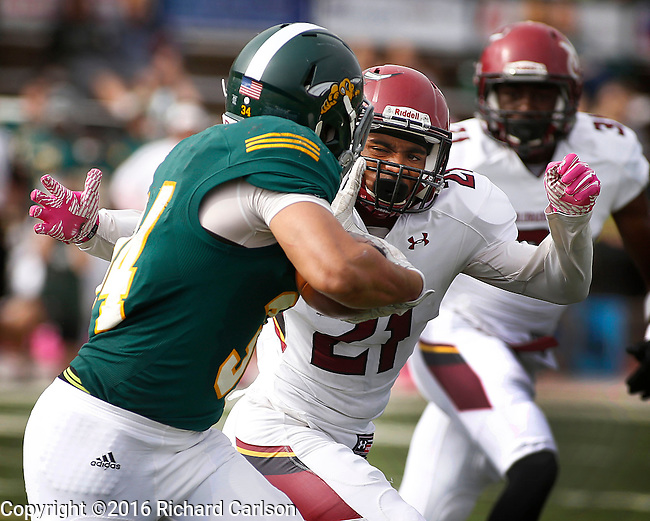 SPEARFISH, SD - OCTOBER 8, 2016 -- Antonio Clark #21 of Colorado Mesa closes in on Black Hills State running back Phydell Paris #34 during their football game at Lyle Hare Stadium in Spearfish, S.D. Saturday. (Photo by Dick Carlson/Inertia)