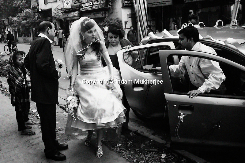An Anglo Indian bride along with her family just before entering the church for her marriage.