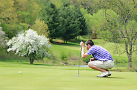 Stoughton's Henry Klongland sets up to putt on the 16th green during boys high school golf on Wednesday, 5/15/13, at House on the Rock / The Springs Golf Course in Spring Green, Wisconsin
