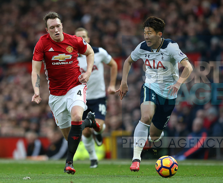 Phil Jones of Manchester United with Son Heung-Min of Tottenham during the English Premier League match at Old Trafford Stadium, Manchester. Picture date: December 11th, 2016. Pic Simon Bellis/Sportimage