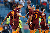 Calcio, Serie A: Roma vs Udinese. Roma, stadio Olimpico, 20 agosto 2016.<br /> Roma&rsquo;s Edin Dzeko, second from left, celebrates with teammates after scoring during the Italian Serie A football match between Roma and Udinese at Rome's Olympic Stadium, 20 August 2016. Roma won 4-0.<br /> UPDATE IMAGES PRESS/Riccardo De Luca