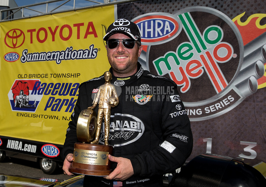 Jun. 2, 2013; Englishtown, NJ, USA: NHRA top fuel dragster driver Shawn Langdon celebrates after winning the Summer Nationals at Raceway Park. Mandatory Credit: Mark J. Rebilas-