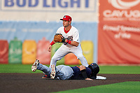 Auburn Doubledays second baseman Jake Alu (9) waits for a throw as Kona Quiggle (23) dives back to the bag during a NY-Penn League game against the Connecticut Tigers on July 12, 2019 at Falcon Park in Auburn, New York.  Auburn defeated Connecticut 7-5.  (Mike Janes/Four Seam Images)