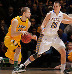 SIOUX FALLS, SD - MARCH 12:  Taylor Braun #24 of North Dakota State drives toward Chad White #25 of South Dakota State during their championship game at the 2013 Summit League Tournament at the Sioux Falls Arena. (Photo by Dick Carlson/Inertia)