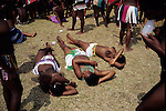 NONGOMA, SOUTH AFRICA - SEPTEMBER 11: Unidentified maidens takes a nap after dancing for hours during the annual Reed Dance on September 11, 2004 in Nongoma in rural Natal, South Africa. About 20.000 maidens from all over South Africa has arrived to dance for Zulu King Goodwill Zwelethini at the Enyokeni Royal Palace in Kwa-Nongoma about 350 kilometers from Durban. The girls come to the kingdom to declare their virginity and the ceremony encourages girls and young women to abstain from sexual activity to curb the spread of HIV-Aids.(Photo: Per-Anders Pettersson)......