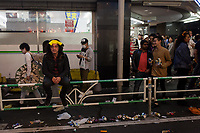 A man wearing Pikachu horns rests outside a convenience store during the Halloween celebrations Shibuya, Tokyo, Japan. Saturday October 27th 2018. The celebrations marking this event have grown in popularity in Japan recently. Enjoyed mostly by young adults who like to dress up, drink , dance and misbehave in parts of Tokyo like Shibuya and Roppongi. There has been a push back from Japanese society and the police to try to limit the bad behaviour.