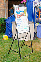 A whiteboard displays results of the corn kernel poll on a rainy day at the Iowa State Fair in Des, Moines, Iowa, on Sun., Aug. 11, 2019.
