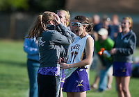 Elkton coach Becky Kreps celebrate an overtime win with players at Elkton High.