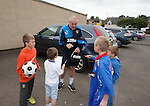Rangers team arrives at Alloa's Indodrill Stadium to train on their synthetic surface ahead of the match on Sunday, manager Mark Warburton takes time out to sign autographs for some young supporters