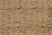 Inscriptions on the walls in the Great Hypostyle Hall, Karnak Temple, Luxor, Egypt.