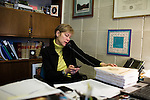 March 17, 2009. Raleigh, NC.. Images from one day in the life of Deborah K. Ross, Representative for North Carolina House District 38.. 9:36 AM. Ross answers phone calls while looking over the governor's budget that was just delivered to her office. The budget has many cuts due to the economic crisis facing the state and country.