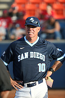 University of San Diego Toreros Head Coach Rich Hill (10) meets with the umpires before a game against the Cal State Fullerton Titans at Goodwin Field on April 5, 2016 in Fullerton, California. Cal State Fullerton defeated University of San Diego, 4-2. (Larry Goren/Four Seam Images)