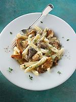 Wiild  chanterelle or girolle (Cantharellus cibarius), Pied de Mouton Mushrooms (hydnum repandum) or hedgehog mushrooms, Pied Bleu of blue foot mushrooms (Clitocybe nuda) with Casarecce Pasta