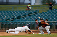 Steve Selsky #13 of the Bakersfield Blaze waits for the throw to first base as Matt Duffy #13 of the Lancaster JetHawks dives back to the bag during a game at The Hanger on July 2, 2013 in Adelanto, California. Lancaster defeated Bakersfield, 12-1. (Larry Goren/Four Seam Images)