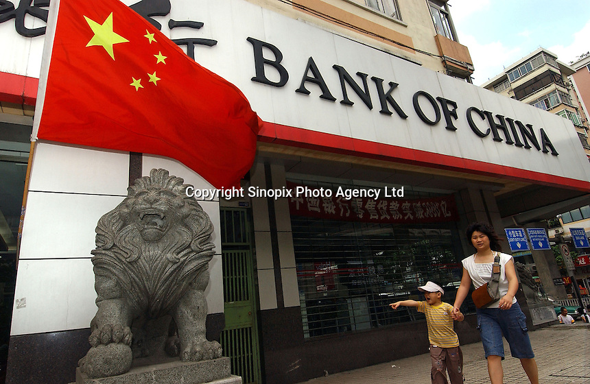 A Chinese flag flies in front of the Bank of China in Guangzhou, China. Chinese banks have been coming under increasing pressure strengthen it's currency which is undervalued according to many western nations..
