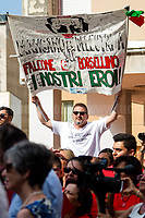 Palermo (Sicily - Italy), 19/07/2017. &quot;Basta depistaggi e omert&agrave; di Stato!&quot; (&quot;Stop red herrings and State's omert&aacute;! - &quot;omert&aacute; is - among the Mafia - a code of silence about criminal activity and a refusal to give evidence to the police&quot; - Source Oxforddictionaries.com) Today, to commemorate the 25th Anniversary of the assassination of the anti-mafia Magistrate Paolo Borsellino and the five members of Borsellino's police &quot;scorta&quot; (escorts from the special branch of the Italian police force who protect Judges) Agostino Catalano, Emanuela Loi (the first Italian female member of the police special branch and the first one to be killed on duty), Vincenzo Li Muli, Walter Eddie Cosina and Claudio Traina a public event was held in Via D'Amelio. Family members of mafia's victims, amongst others, made speeches about their dramatic experiences, mafia's violence and unpunished crimes, and State's misdirection, silence, red herrings. Speakers included, amongst others, Vincenzo Agostino &amp; Augusta Schiera, Salvatore &amp; Cristina &amp; Antonella Catalano, Graziella Accetta &amp; Ninni Domino, Massimo Sole, Paola Caccia, Luciano Traina, Gianluca &amp; Angela Manca, Nunzia &amp; Stefano Mormile, Ferdinando Imposimato, Judge Nino Di Matteo. The event ended with the screening of the docufiction RAI 'Adesso Tocca A Me' (Now it is my turn - Watch it here: http://bit.ly/2w3WJUX) by G. Filippetto &amp; F. Miccich&egrave;.<br /> <br /> For more info &amp; a video of the event please click here: http://bit.ly/2eQfNT3 &amp; http://bit.ly/2eQbmrj &amp; http://19luglio1992.com &amp; https://www.facebook.com/agenderosse/