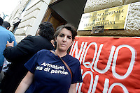 Roma 8 Luglio 2014<br /> Manifestazione dei giornalisti precari e freelance contro la  Federazione Nazionale della Stampa Italiana e contro il contratto  firmato con gli editori della Fieg e accordo sull'equo compenso, davanti alla sede della Fnsi.<br /> Rome, July 8, 2014 <br /> Demostration of the precarious journalists and freelance against the National Federation of the Italian Press and against the contract signed with the publishers of Fieg and agreement on fair compensation, in front of the headquarters of the FNSI.