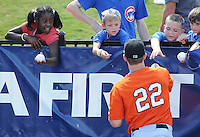 Outfielder Ryan Lollis (22) of the Augusta GreenJackets signs autographs for fans before a game against the Greenville Drive on May 23, 2010, at Fluor Field at the West End in Greenville, S.C. Photo by: Tom Priddy/Four Seam Images