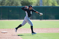 Chicago White Sox shortstop Luis Curbelo (21) throws to first base during an Instructional League game against the Kansas City Royals at Camelback Ranch on September 25, 2018 in Glendale, Arizona. (Zachary Lucy/Four Seam Images)