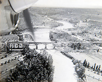 BNPS.co.uk (01202 558833)<br /> Pic: PhilYeomans/BNPS<br /> <br /> Flt Lt Cooper's view from a P38 Lightning of a destroyed bridge over the Tiber near Rome.<br /> <br /> Unearthed - fascinating unseen archive of cameras, photographs, documents and medals from a British aerial reconnaisance expert who fought all the way through Africa and southern Europe in WW2.<br /> <br /> Flt Lt Eric Cooper from London kept all his wartime paraphernalia, including his K20 handheld camera and stereoscopic plotting instruments until his death in Devon aged 96 in 2012.<br /> <br /> The incredible photographs show bombing raids, amphibious landings and badly damaged aircraft alongside off duty snaps of the campaign throughout the mediterraenean.<br /> <br /> His nephew is now selling the compelling collection at Plymouth Auction Rooms in Devon next week.