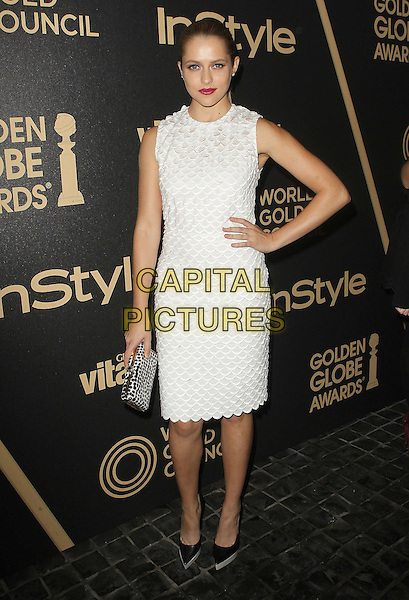 Teresa Palmer.The Hollywood Foreign Press Association And InStyle Miss Golden Globe 2013 Party held at Cecconi's Restaurant, West Hollywood, California,.USA, 29th November 2012..full length white  sleeveless dress  scallop edge pointy platform shoes hand on hip .CAP/ADM/KB.©Kevan Brooks/AdMedia/Capital Pictures.