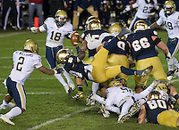 Cierre Wood dives over the pile for an apparent TD but loses the ball as he crosses the goal line.