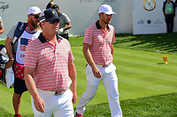 Charley Hoffman (USA) and Kevin Chappell (USA) depart the first tee during round 2 Four-Ball of the 2017 President's Cup, Liberty National Golf Club, Jersey City, New Jersey, USA. 9/29/2017.<br /> Picture: Golffile | Ken Murray<br /> <br /> All photo usage must carry mandatory copyright credit (&copy; Golffile | Ken Murray)