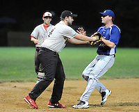 Ohev Shalom's Art Anderson, left, tags out Shir Ami's Dr. Mark Bernstein during a Delaware Valley Synagogue League modified fast pitch softball playoff game Monday August 1, 2016 in Southampton, Pennsylvania. (Photo by William Thomas Cain)