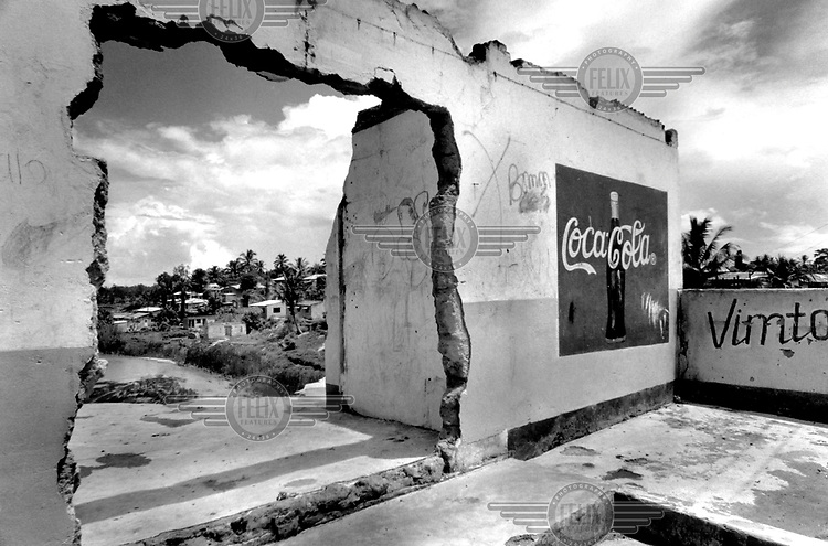©Dieter Telemans/Panos Pictures..Tanzania, Dar es Salaam...Graffiti and Coca Cola advertisement in the Manzese district.