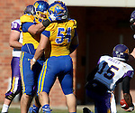 BROOKINGS, SD - OCTOBER 24:  Kellen Soulek #94 celebrates with Cole Langer #54 from South Dakota State tafter a sack on quarterback Aaron Bailey #15 from University of Northern Iowa in the first quarter of their game Saturday afternoon at Coughlin Alumni Stadium in Brookings. (Photo by Dave Eggen/Inertia)