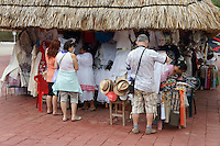 Tourists shopping for clothing and handicrafts outside the Mayan ruins of Uxmal, Yucatan, Mexico.