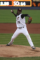 Quad Cities River Bandits pitcher Akeem Bostick (39) delivers a pitch during a Midwest League game against the Wisconsin Timber Rattlers on May 8th, 2015 at Modern Woodmen Park in Davenport, Iowa.  Quad Cities defeated Wisconsin 11-6.  (Brad Krause/Four Seam Images)