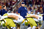Blacksburg, VA - OCT 6, 2018: Notre Dame Fighting Irish head coach Brian Kelly watches over his team during warm up before game between Notre Dame and Virginia Tech at Lane Stadium/Worsham Field Blacksburg, VA. (Photo by Phil Peters/Media Images International)