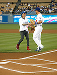 LOS ANGELES, CA. - September 02: Pete Wentz and Brad Ausmus of the Los Angeles Dodgers throwing the ceremonial first pitch at Dodger Stadium in Los Angeles, California on September 2, 2009.