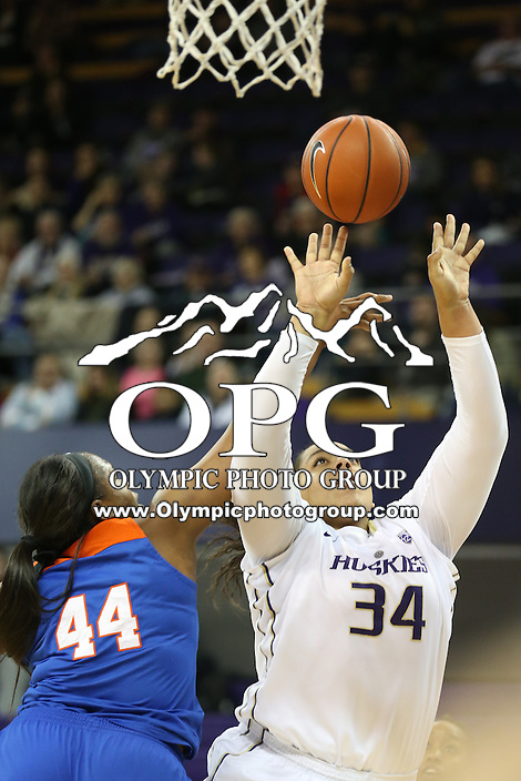 SEATTLE, WA - DECEMBER 18: Washington's #34 Deja Strother drives to the basket against Savannah State.  Washington won 87-36 over Savannah State at Alaska Airlines Arena in Seattle, WA.
