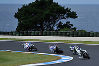 PHILLIP ISLAND, 27 FEBRUARY - Riders cornering through Siberia turn during race one of round one of the 2011 FIM Superbike World Championship at Phillip Island, Australia. (Photo Sydney Low / syd-low.com)