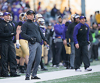 Chris Petersen tries to add a little body English to a missed field goal attempt.