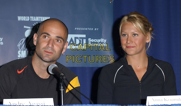 ANDRE AGASSI & ANNA KOURNIKOVA.Attends the 12th Annual World Team Tennis Smash Hits Press Conference benefiting The Elton John AIDS Foundation held at The Bren Events Center at UC Irvine in Irvine, California on October 11th 2004..portrait headshot .Ref: DVS.www.capitalpictures.com.sales@capitalpictures.com.©Debbie VanStory/Capital Pictures .