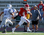 SIOUX FALLS, SD, AUGUST 27:  Eric Looby #5 from Sioux Falls Lincoln scampers down the sideline past Gentry Raue #40 and Sam Galster #13 from Rapid City Stevens in the first half of their game Saturday night at Howard Wood Field. (Photo by Dave Eggen/Inertia)