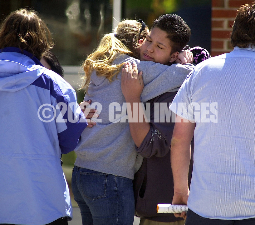 RED LION, PA - APRIL 24: Brandi Berger, second from left, is hugged by an unidentified student outside Red Lion Senior High School after a grief counseling session April 24, 2003 in Red Lion, Pennsylvania. Red Lion Junior High School student James Sheets alledgedly shot and killed Principal Eugene Segro, then turned the gun on himself before the start of classes April 24, 2003. Berger is said to have been the girlfriend of shooter Sheets. (Photo by William Thomas Cain/Getty Images)
