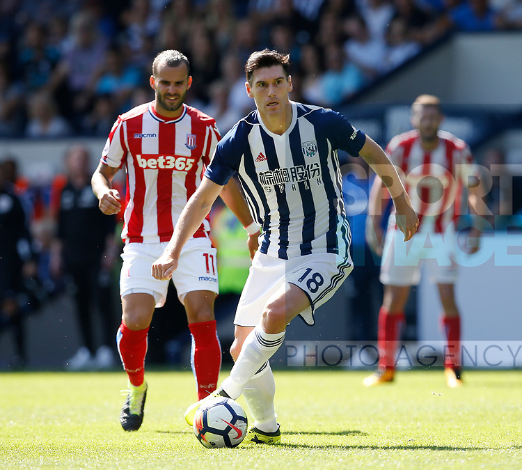 Gareth Barry of West Bromwich Albion gets in front of Jese of Stoke City during the premier league match at the Hawthorn's Stadium, West Bromwich. Picture date 27th August 2017. Picture credit should read: Simon Bellis/Sportimage