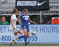 Boston Breakers substitute defender Maddy Evans (18) dribbles down the wing. In a National Women's Soccer League (NWSL) match, Boston Breakers (blue) defeated Sky Blue FC (white), 3-2, at Dilboy Stadium on June 30, 2013.