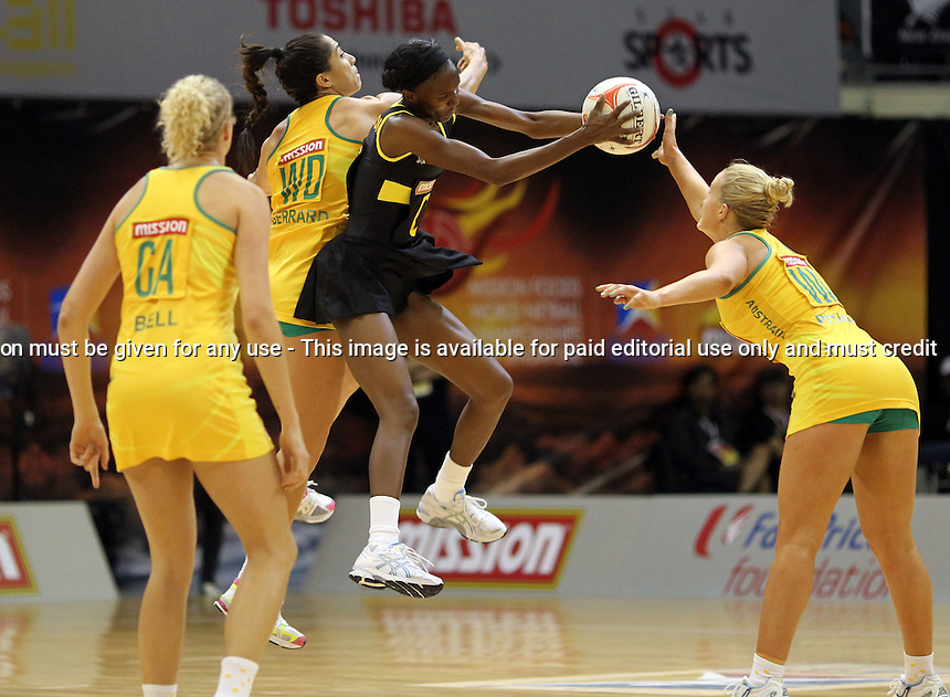 09.07.2011 Australia's Mo'onia Gerrard and Jamaica's Paula Thompson in action during the netball match between Jamaica and Australia at the Mission Foods World Netball Championship 2011 held at the Singapore Indoor Stadium in Singapore . Mandatory Photo Credit ©Michael Bradley.