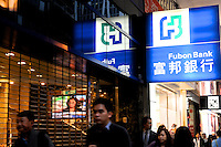 People pass Fubon Bank in Hong Kong. Fubon is a subsidiary of Fubon Financial Holding Co., Ltd. of Taiwan, the organization was known as International Bank of Asia, more commonly known as IBA.