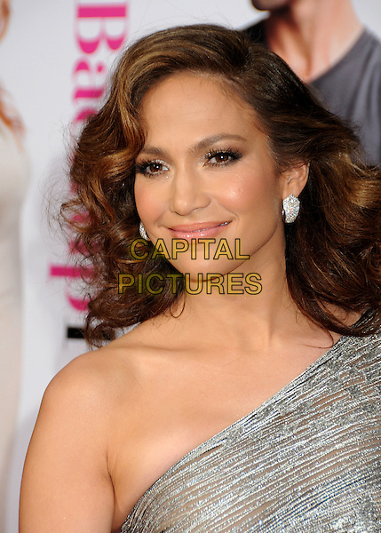 "JENNIFER LOPEZ .""The Back-up Plan"" Los Angeles Premiere held at the Regency Village Theatre, Westwood, California, USA, 21st April 2010..arrivals portrait headshot one shoulder silver smiling wavy hair earrings make-up beauty .CAP/ADM/BP.©Byron Purvis/AdMedia/Capital Pictures."