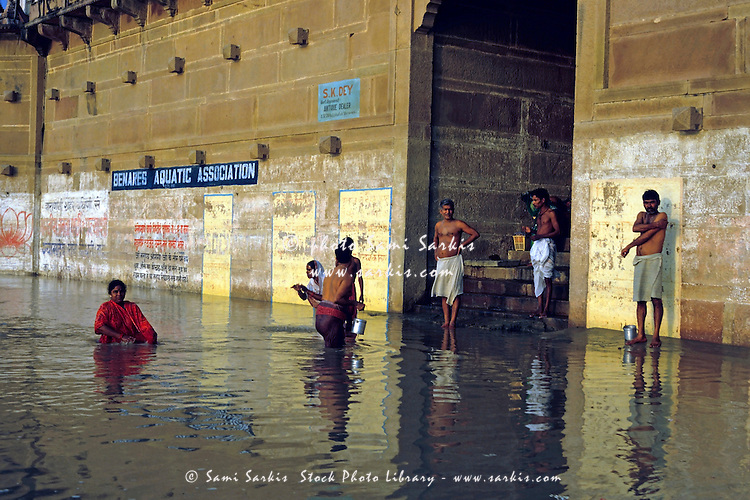 Men and women performing ablutions in the Ganges, Varanasi, India.