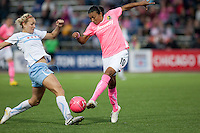 Marta (right) kicks the ball against Natalie Spilger (left). FC Gold Pride tied the Chicago Red Stars 0-0 in PUMA's Project Pink, Think Pink, Breast Cancer Awareness game at Pioneer Stadium in Hayward, California on August 7th, 2010.